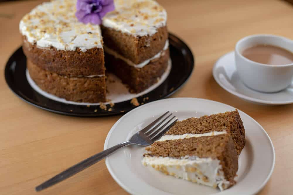 A coffee cake and coffee at the Heritage cafe, Walton Hall and Gardens. Plan your visit to Walton.
