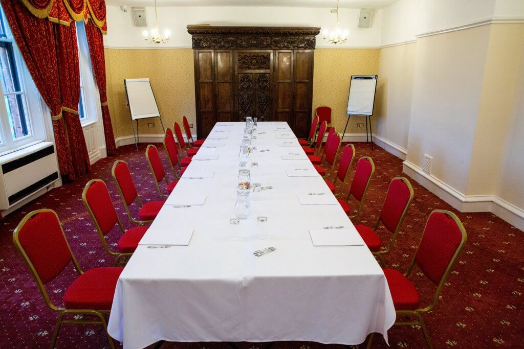 Large banqueting table set up in the Daresbury room
