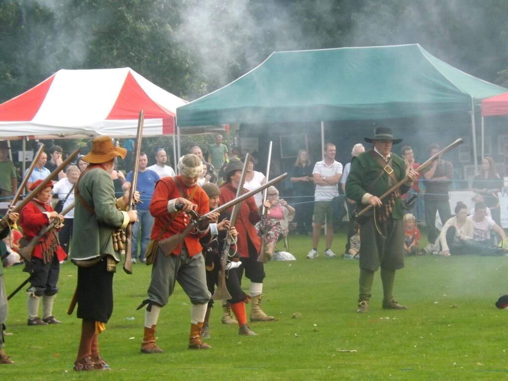 English civil war reenactments with guns at Walton Hall and Gardens Country Fair