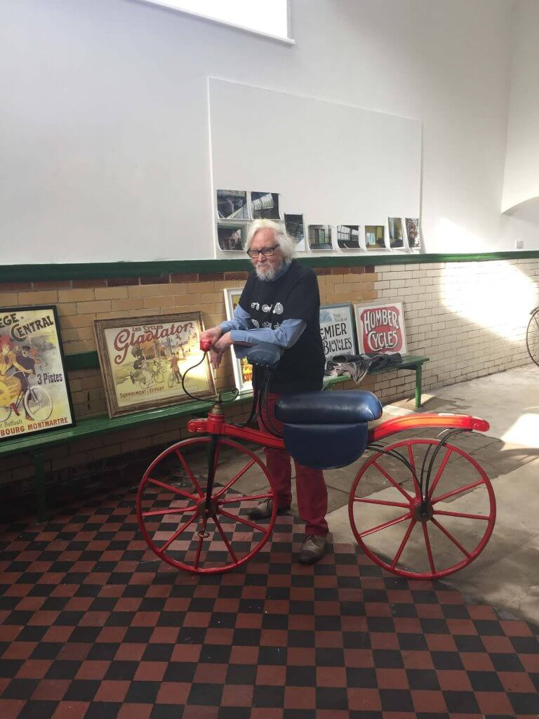 Paul with a beautiful bike inside the cycle museum