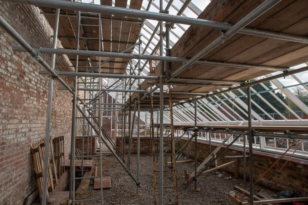 Scaffold erected inside the glasshouses