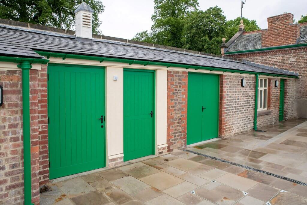 The doors in the shippon yard newly repainted and snapped for the glasshouses restoration gallery by Andy Gilbert