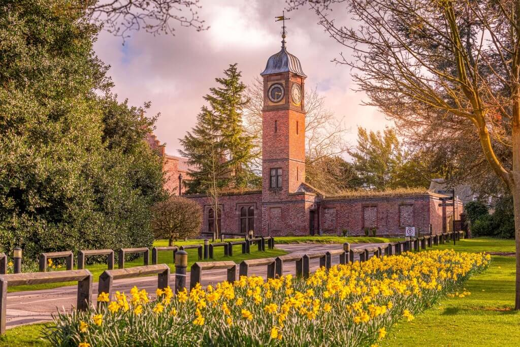 Walton Hall and Gardens in springtime with daffodils