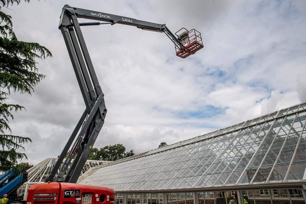 Man on a cherry picker. Picture captured by Andy Gilbert for the glasshouses restoration gallery