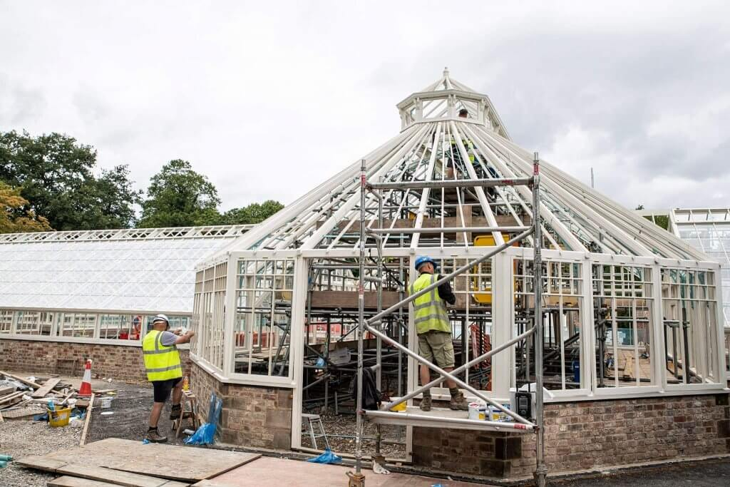 Man working on scaffold up against the conservatory. Glasshouses restoration gallery pic taken by Andy Gilbert.