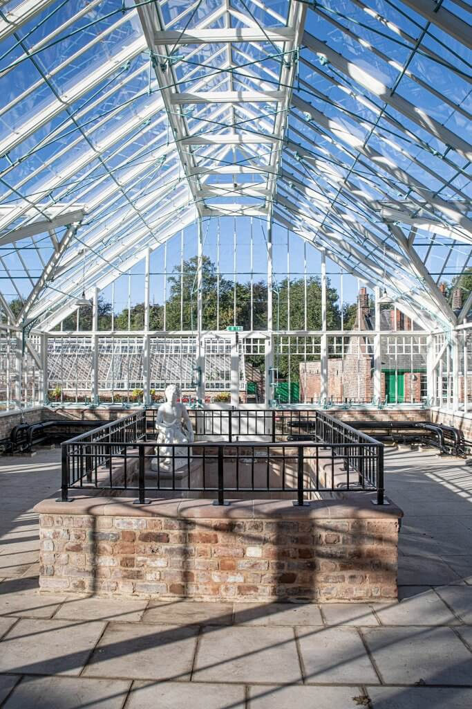 The newly restored glasshouses in the autumn sunshine