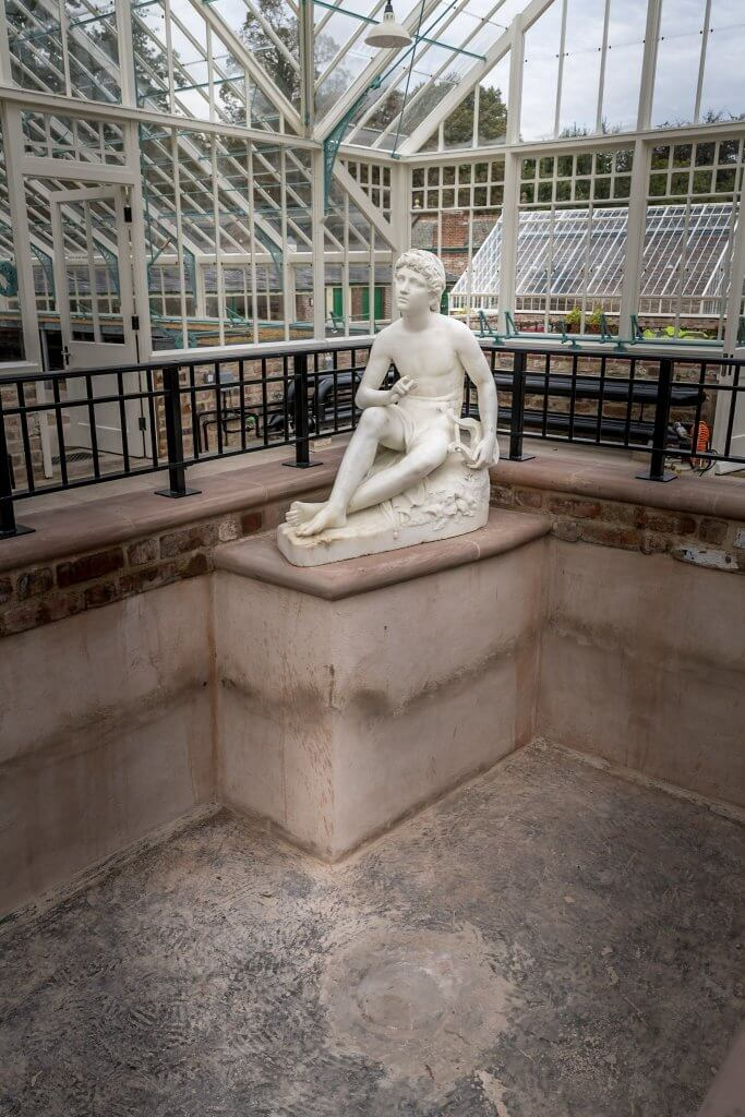 The statue in the empty pool, waiting for water at the newly refurbished glasshuses