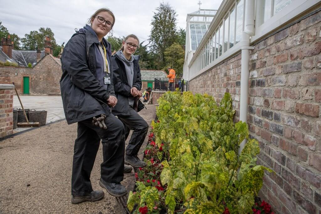 Myerscough students undertaking work at the restored glasshouses
