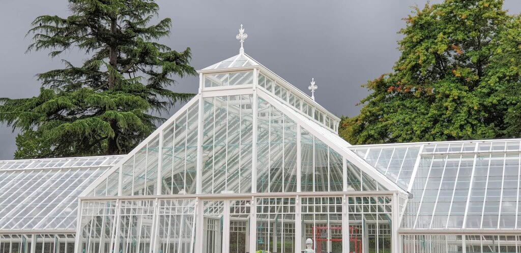 Glasshouses looking stunning under the dark storm clouds
