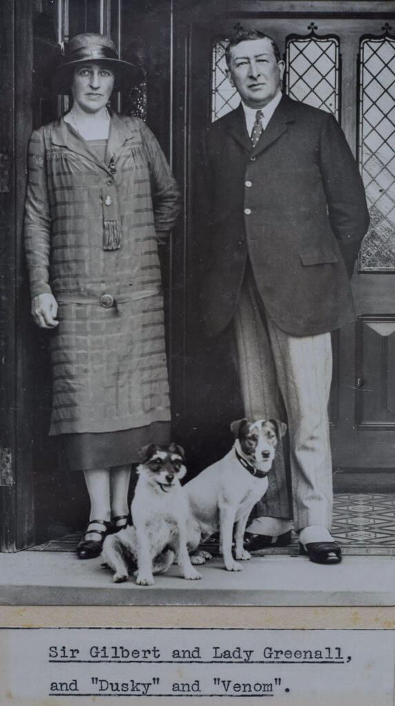 Lord and Lady Daresbury posing with their dog in the entrance to Walton Hall and Gardens. Part of the heritage of the estate.