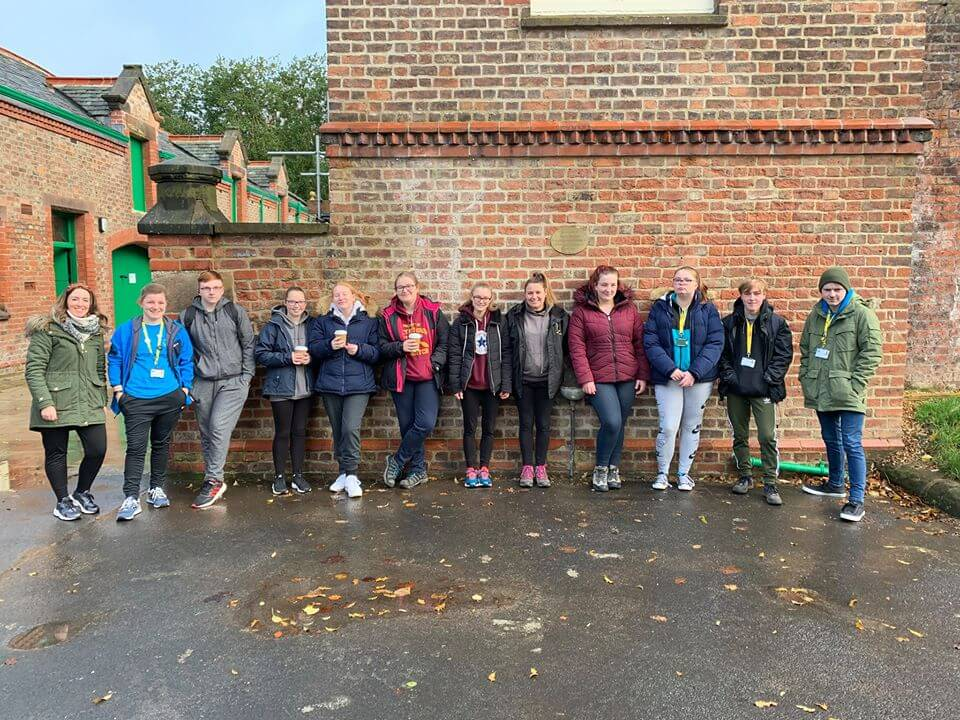 Myerscough students gathered outside the conservatories and glasshouses at Walton Hall and Gardens