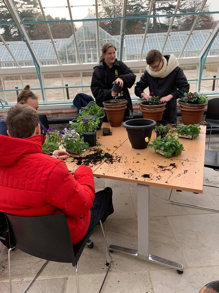 Myerscough students working at the newly restored glasshouses