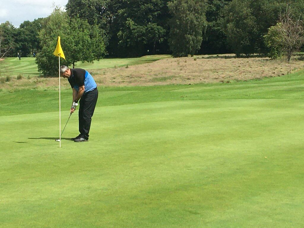 A man on the putting green at Walton Hall Golf Club