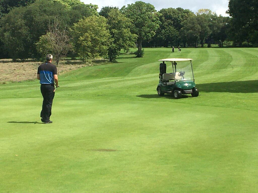 Man and buggy on the green at Walton Hall Golf Club