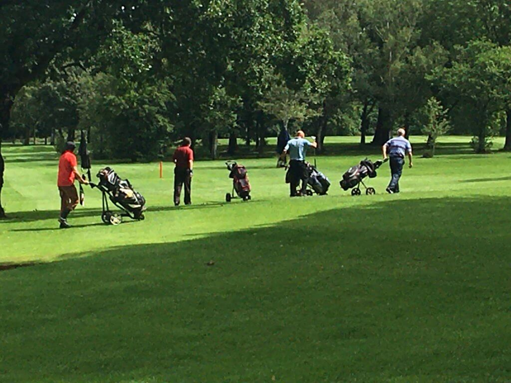A group of friends on the greens at Walton Hall Golf Club