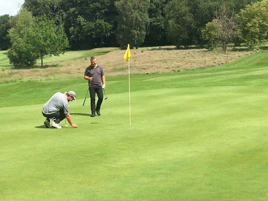 Two men on the putting green at Walton Hall Golf Club